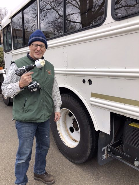 Joe drills the first holes in the bus